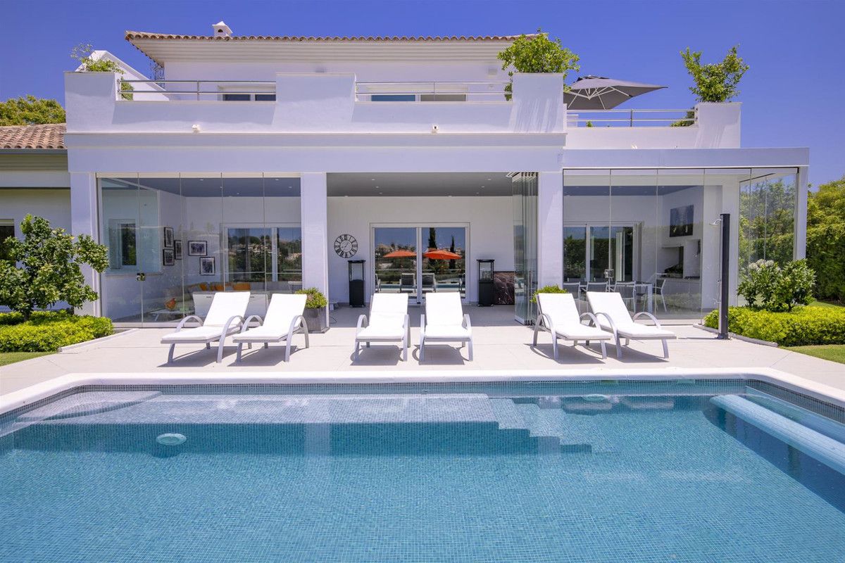 Located in a lovely corner of the exclusive Santa Maria golf course in Elviria, this elegant villa h,Spain