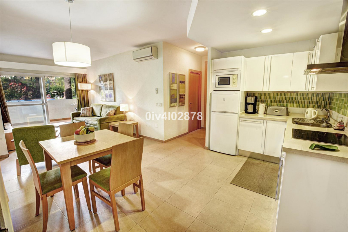 Great size apartment located in the highly sought after Benal Beach complex. This apartment is much ,Spain