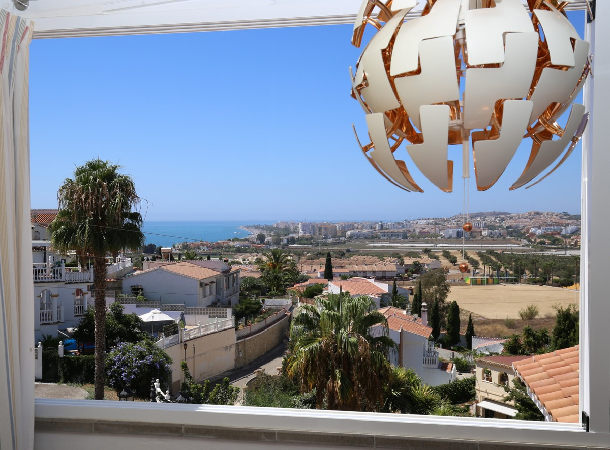 Just 800 metres from the beach is this two-storey terraced house in Caleta. The property has a total,Spain