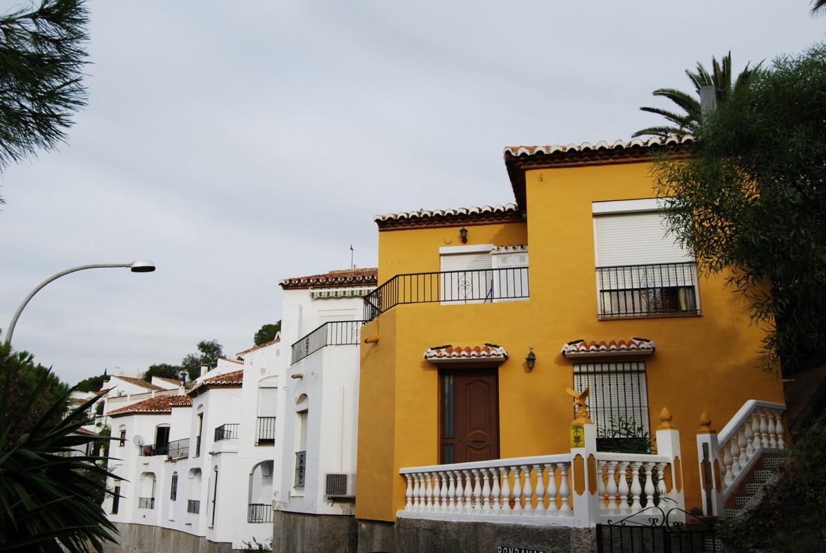 Townhouse Caleta de Velez  Semidetached townhouse with 2 terraces This corner house is in a quiet an,Spain