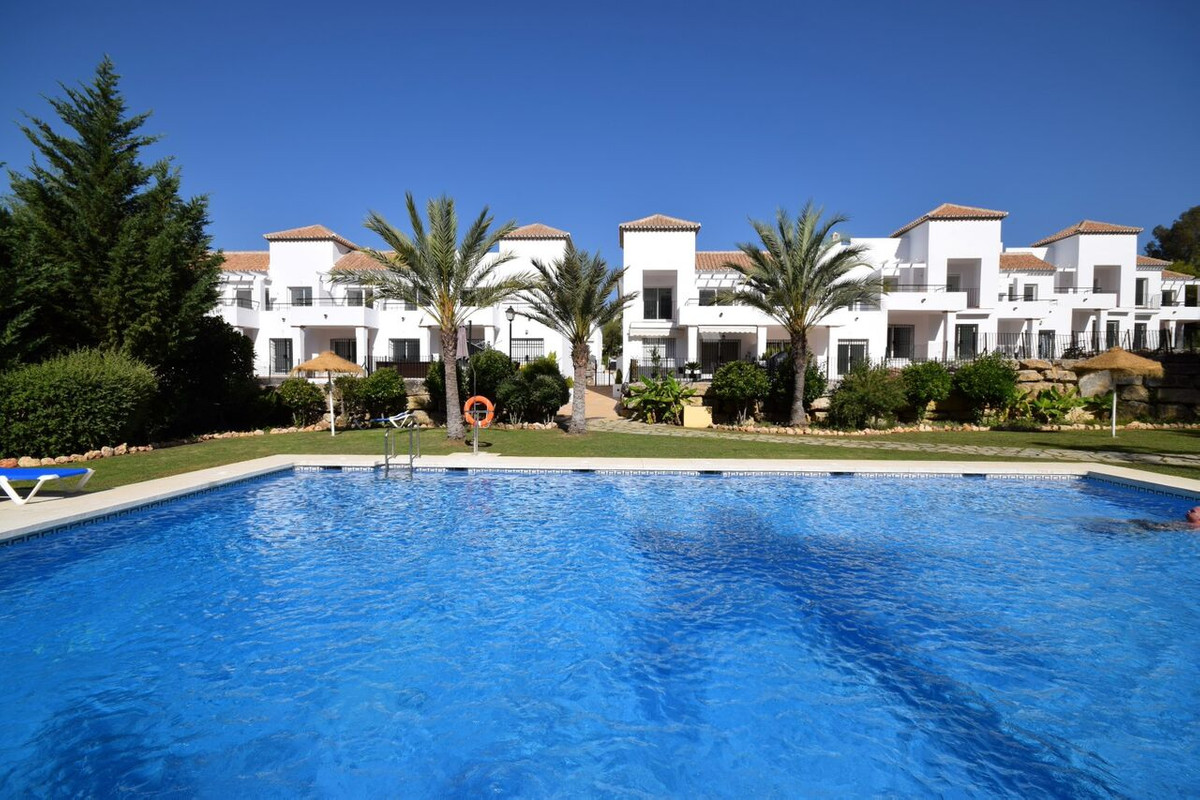 - 2 bedroom apartment in a low-rise Andalusian style enclosed complex with beautiful gardens. The co,Spain