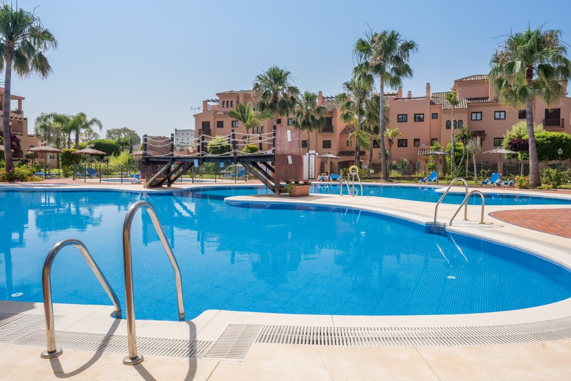 Beautiful corner 2 bed first floor apartment with views to the sea in a unique location on the devel,Spain