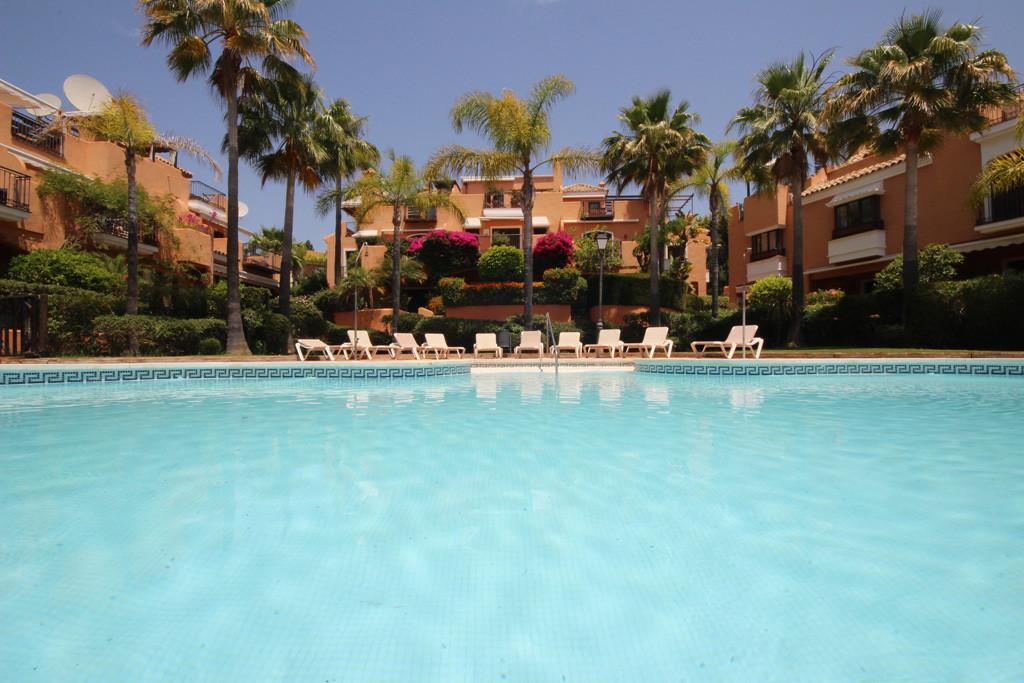 This beautiful quality semi-detached house is situated in Las Salinas estate in Bahia de Marbella ju,Spain