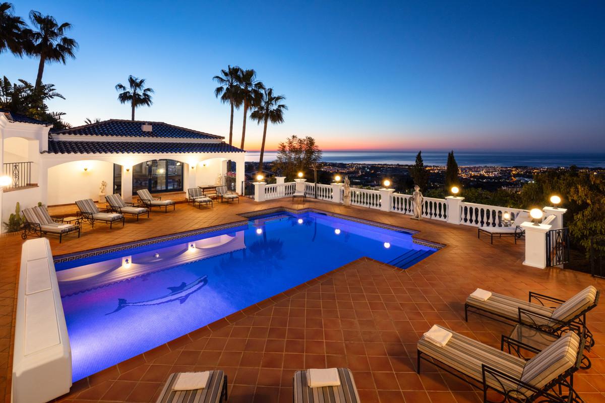 Large villa with tennis court close to Marbella. The prestigious Cortijo style villa has some of the,Spain