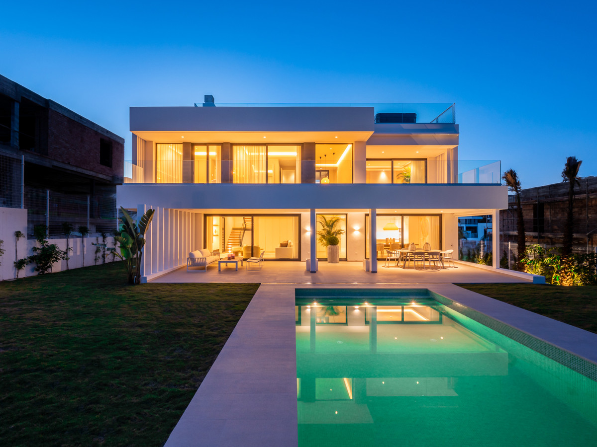 Beautiful modern villa with south orientation and panoramic views to the sea. Located in Cancelada (,Spain