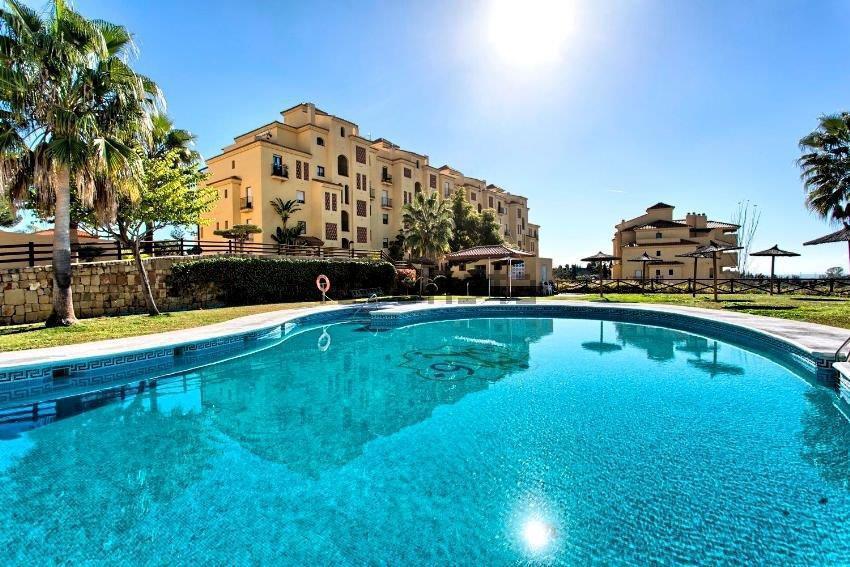Well presented two bedroom, two bathroom, west facing ground floor apartment in La Resina, between S,Spain