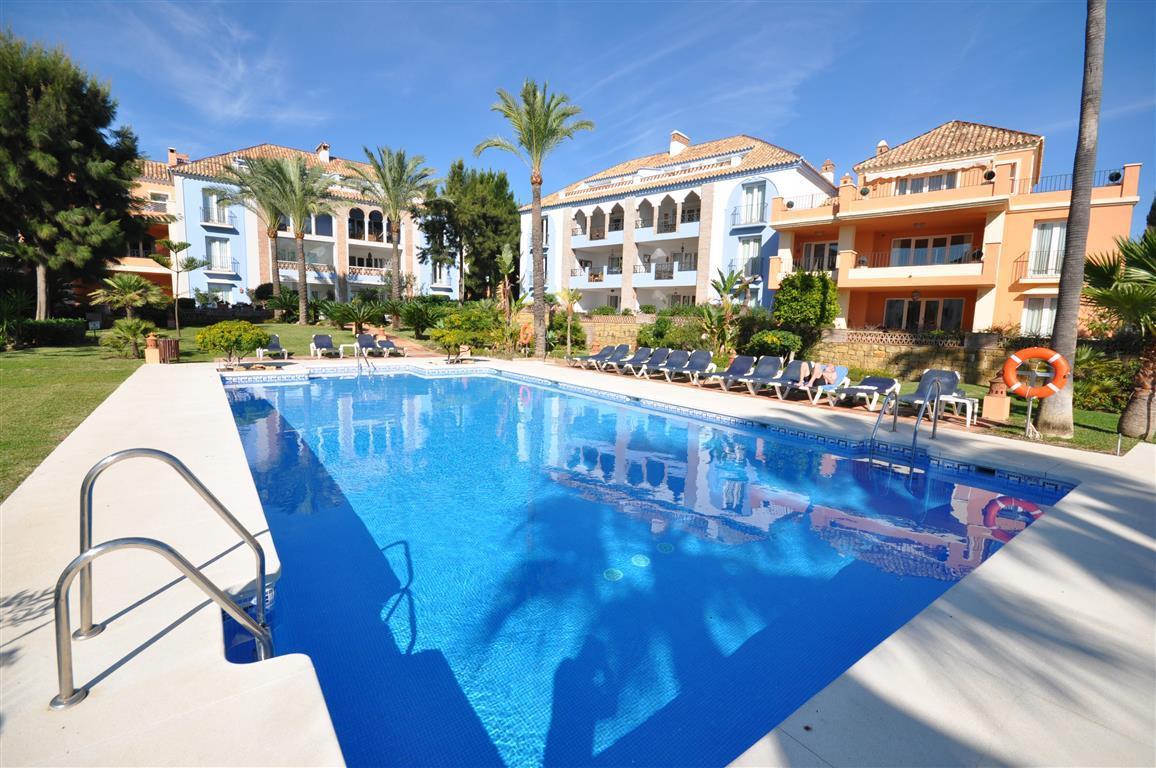 Luxury front line exclusive beach- first floor apartment. Located in La Perla de la Bahia a really b,Spain