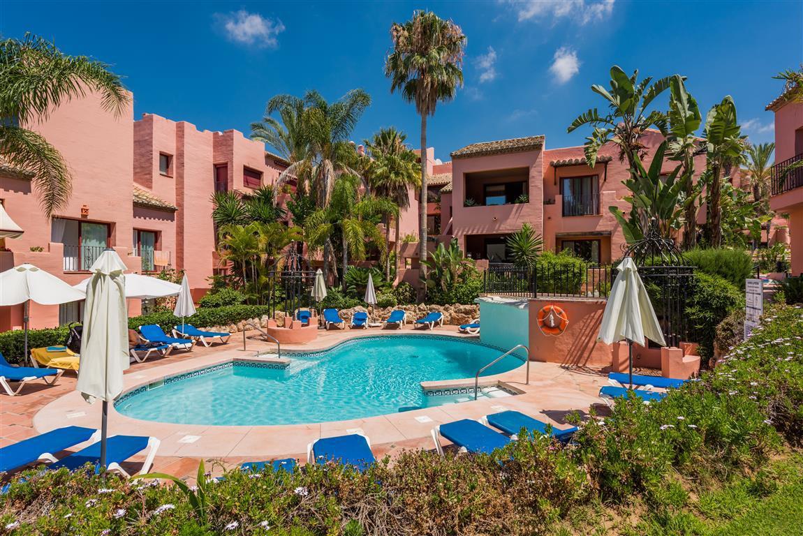 Set in one of the most desirable beachside Elviria private urbanisations, boasting mature fragrant g,Spain