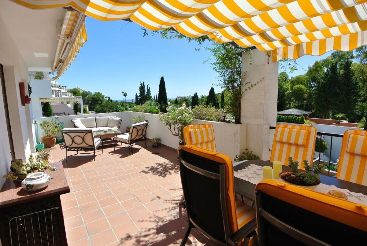 This beautiful corner apartment is located in an established urbanization in Las Lomas del Marbella ,Spain