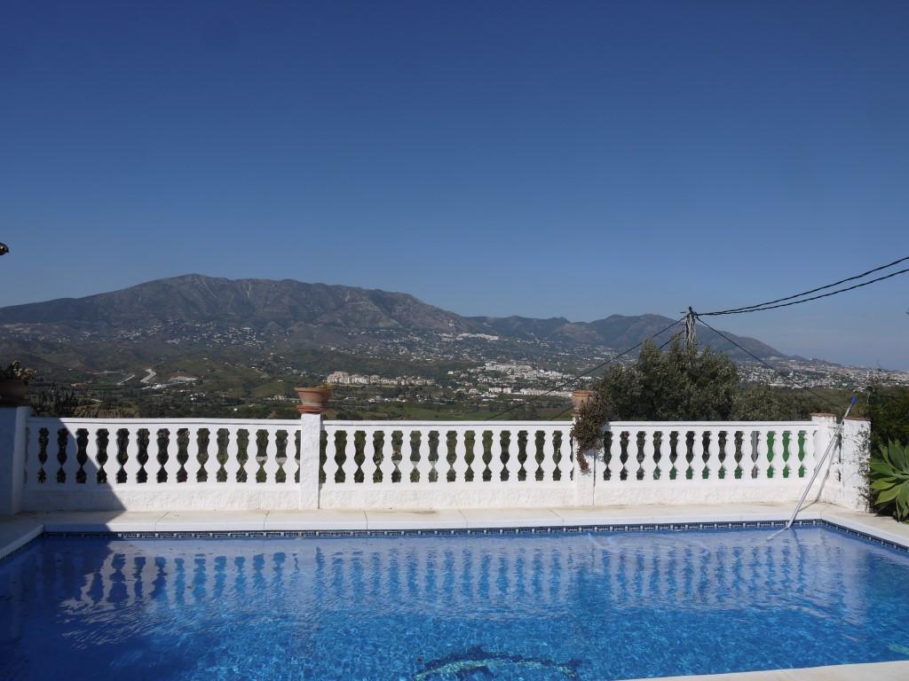 Magnificent villa located on the edge of La Cala De Mijas, this stunning 5 bedroom villa provides th,Spain