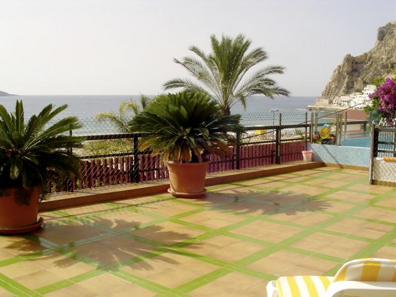 Singular home in privileged beach location in Cala Benidorm.  This beach apartment is accessed via a,Spain