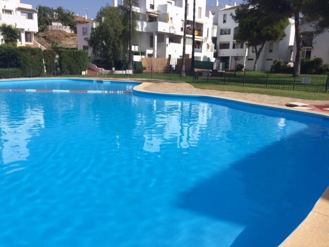 Ground floor apartment in Parque Elviria, Marbella. Gated urbanization with gardens and communal poo,Spain