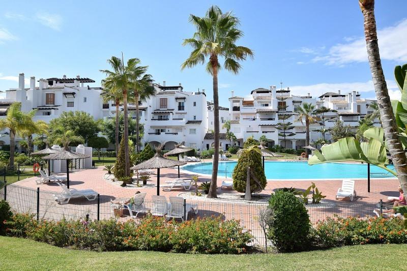 Spacious garden apartment situated in the frontline beach development Las Adelfas, San Pedro. The pr,Spain