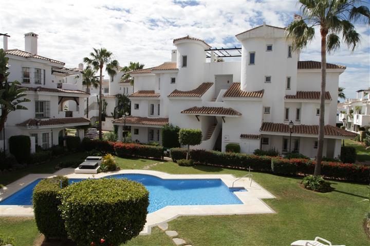 Large 2 bedroom apartment overlooking the communal pool in the very popular Los Naranjos De Marbella,Spain