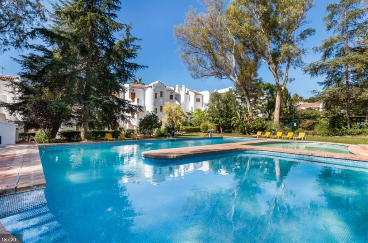 Corner south west facing 2 bedroom ground floor apartment, Le Village, Nueva Andalucia. The developmSpain