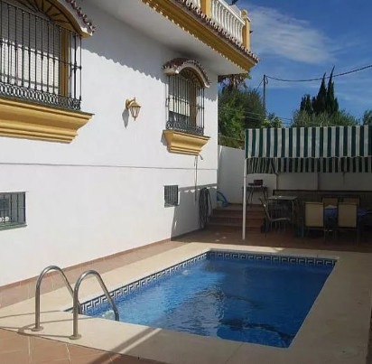 Charming  villa of 236m2 located in Urbanization El Romeral (Alhaurin de la Torre). This property co,Spain