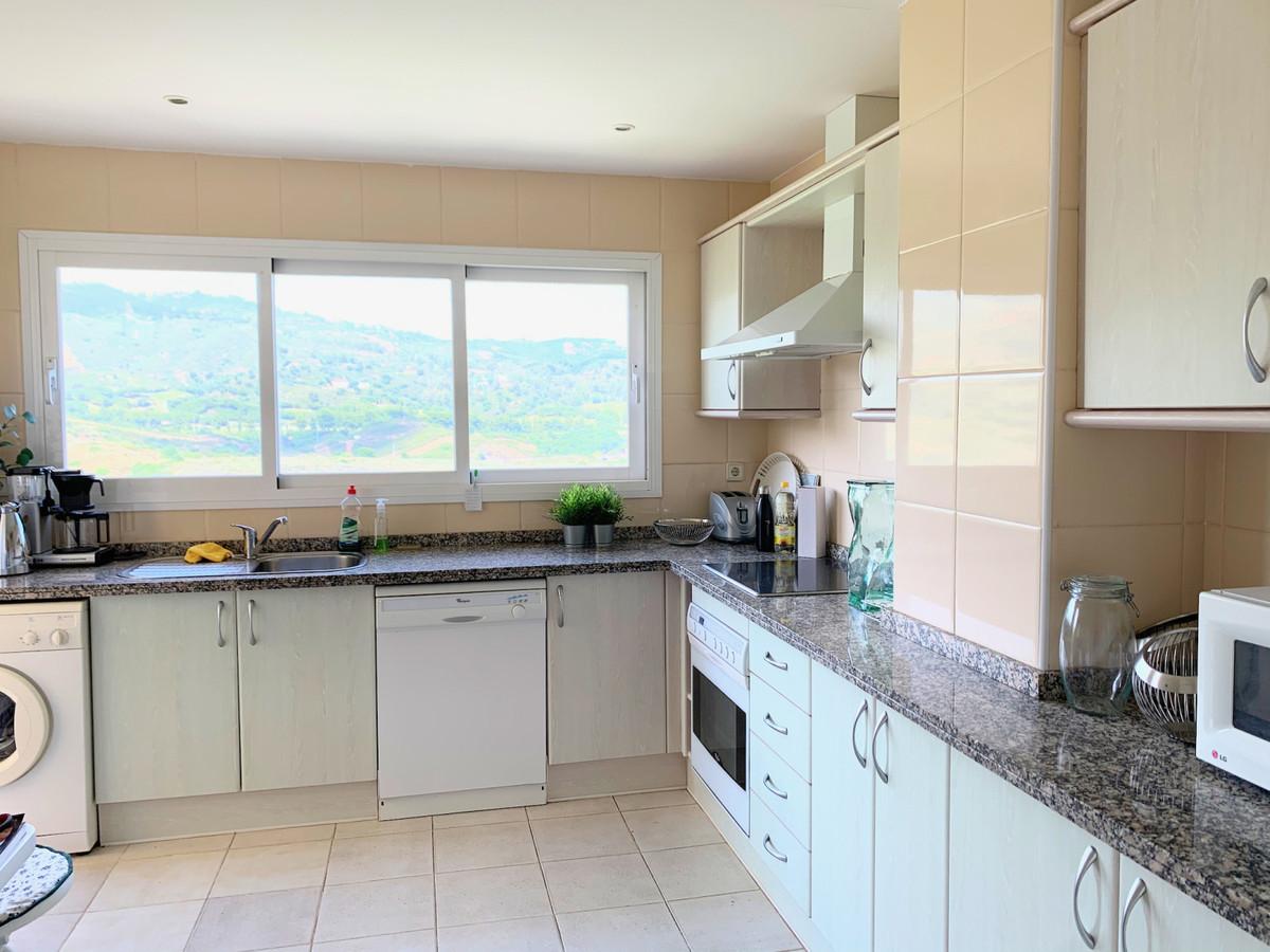 This fantastic corner apartment is located in the popular urbanization of Elviria Hills. It is locat,Spain