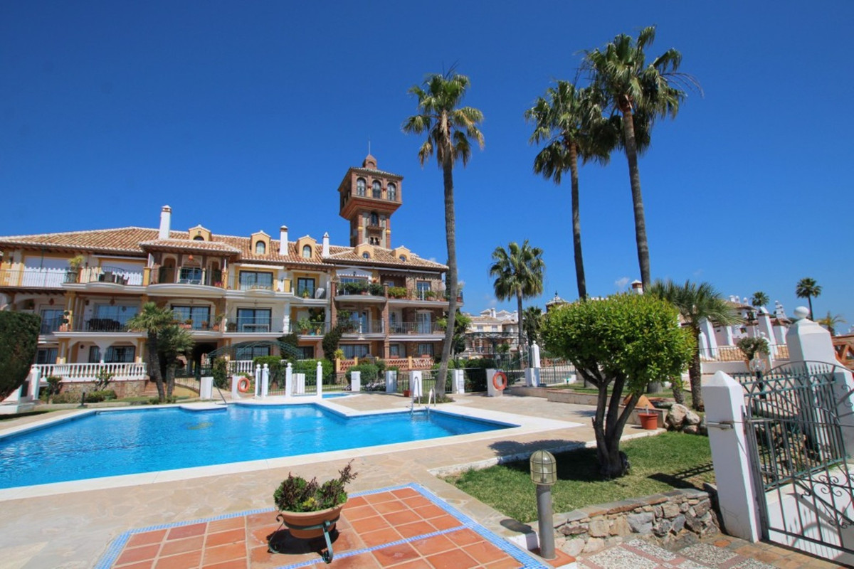 A 3 Bedroom Town house in the beautiful Andalusian styled community of Puebla Aida. This is a home t,Spain