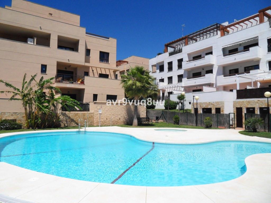 A beautifully presented 1 bedroom elevated ground floor apartment located in the Cala Blanca urbaniz,Spain