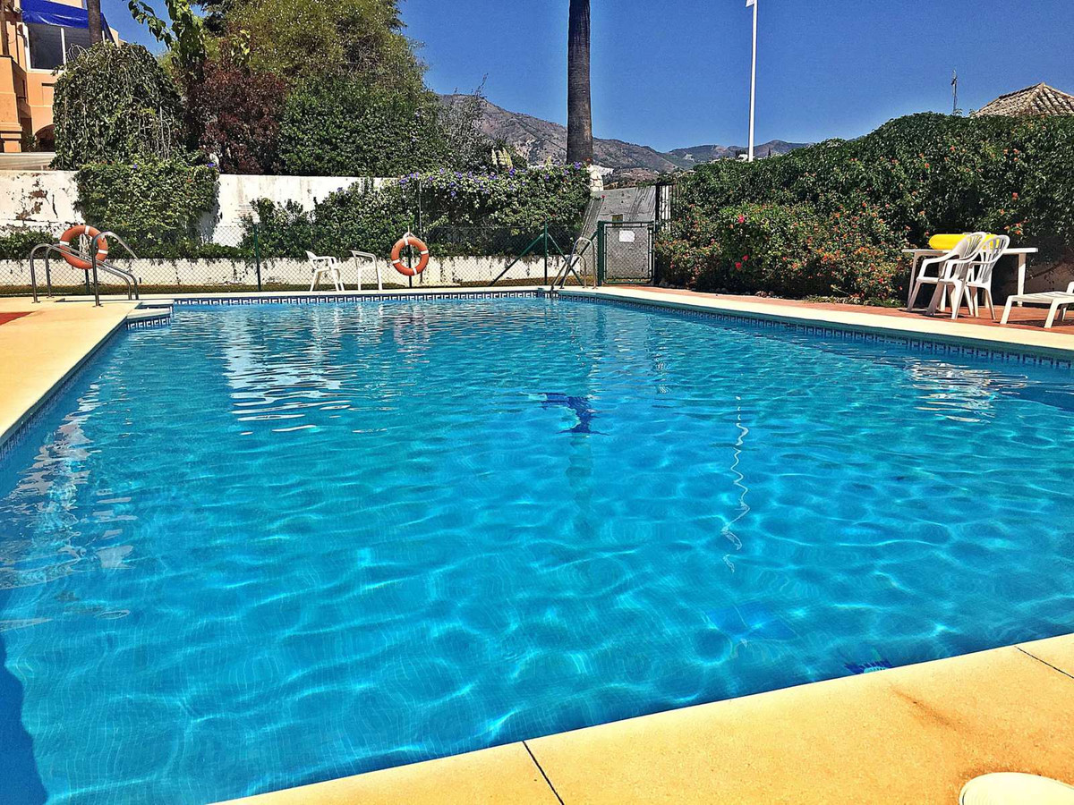 Modernized 2 bedroom property in front-line golf community on Mijas Golf! This well presented 2 stor,Spain