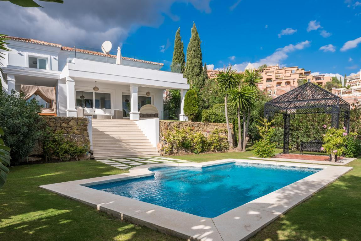 A fully refurbished family villa in the sought after area of La Cerquilla. The house is accessed thr,Spain