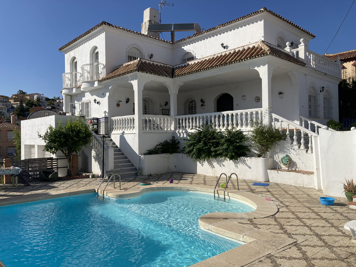 Large villa on two linked plots walking distance to amenities.   The spacious and elegant 3-storey h,Spain