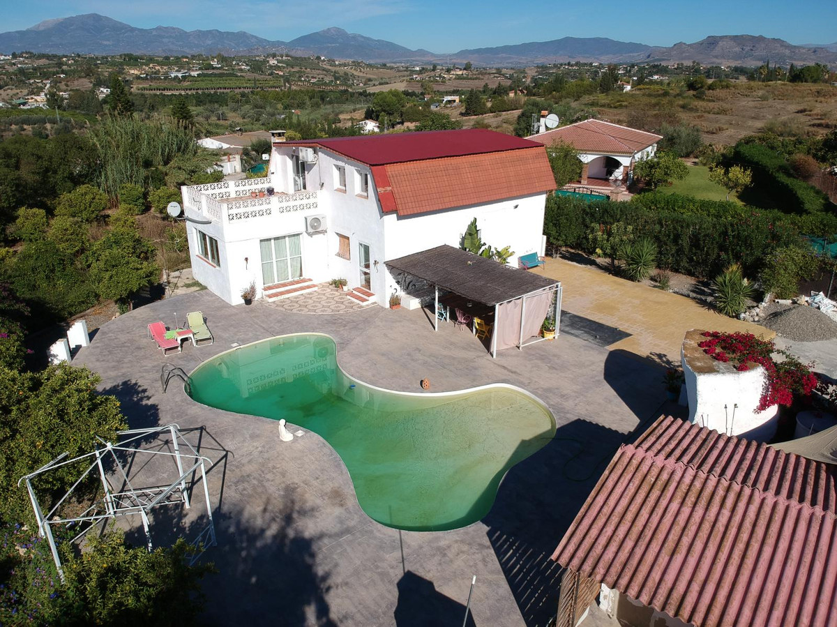 Country property located between the village of Coin & Cartama.  Electric gates lead to a large ,Spain