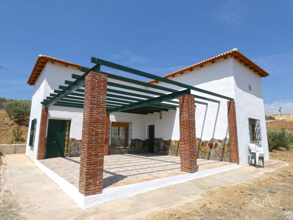 Southwest facing country home in Coin with beautiful panoramic views.  The house is built over two f,Spain