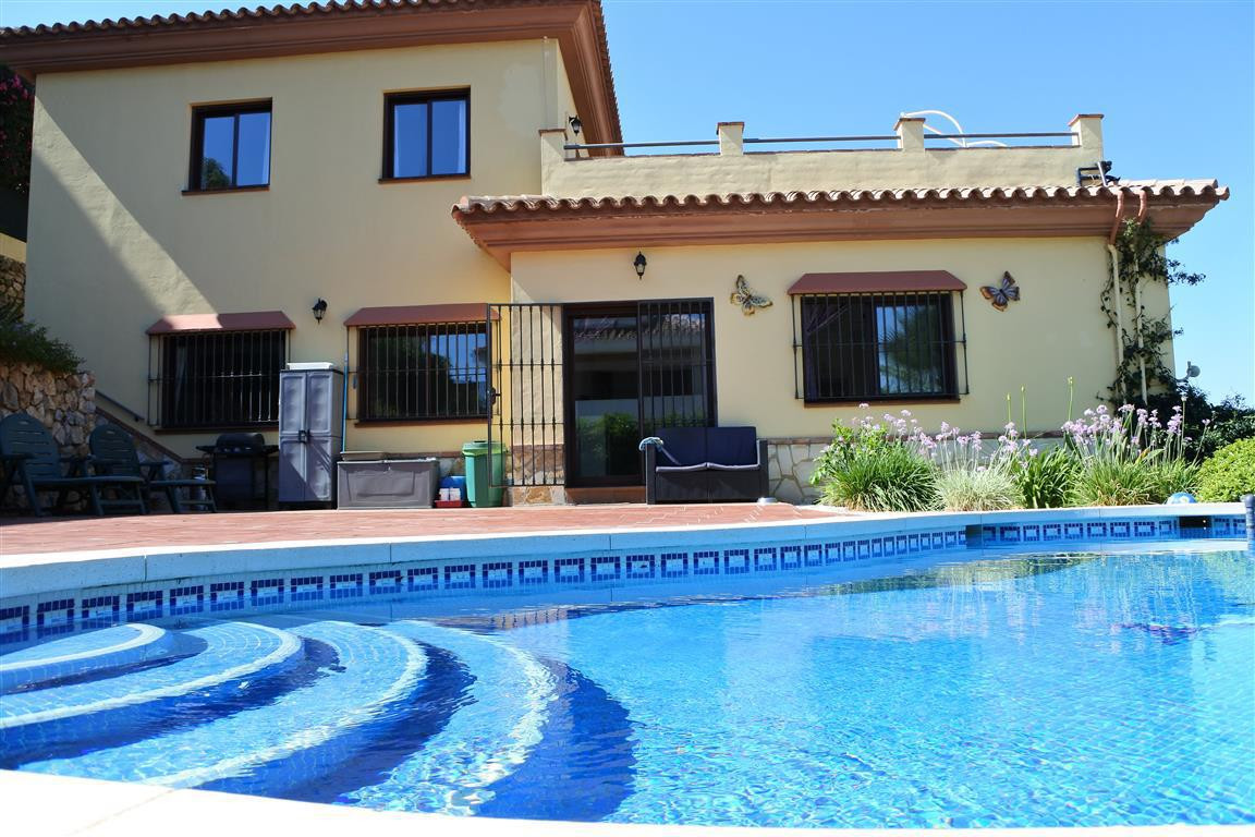 An extremely spacious and well-proportioned 3-storey villa, located on a quiet urbanisation on the o,Spain