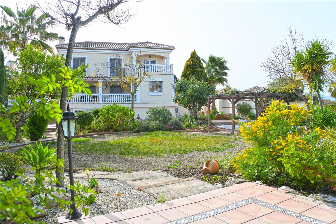 This fabulous 3 storey villa with pool is located on a quiet urbanisation on the outskirts of Coin. ,Spain