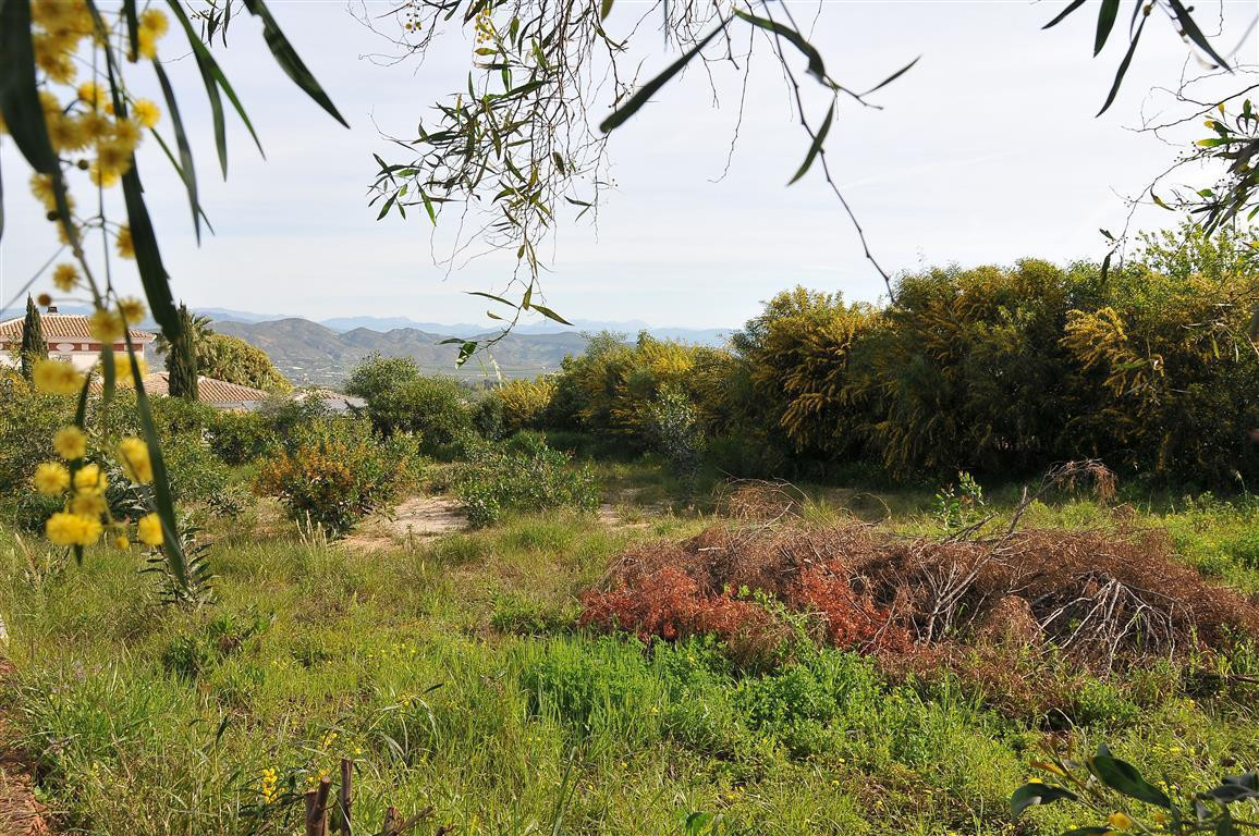 Nice flat plot in a very private urbanisation close to Alhaurin el Grande with fantastic views. Poss,Spain
