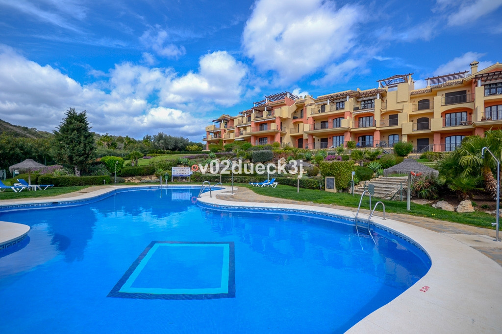 This immaculate apartment offers stunning views of the golf course, mountains and sea. It is located,Spain