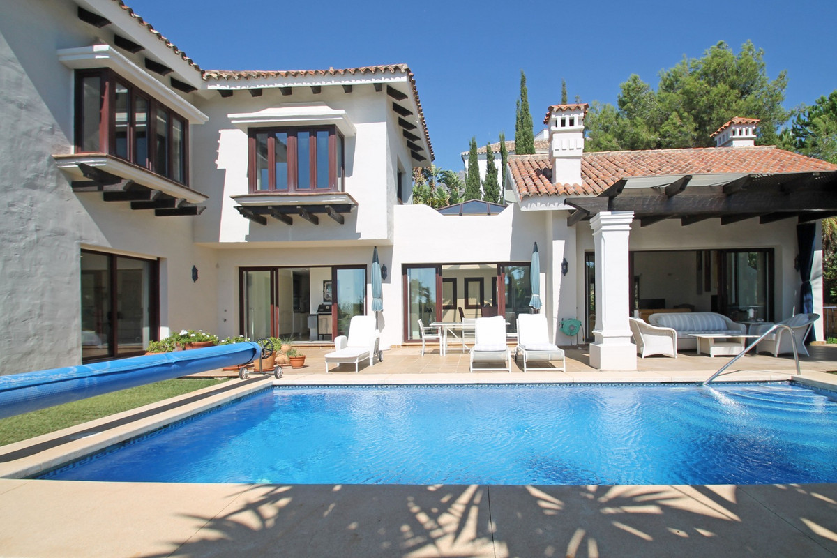 Magnificent, elegant and classic villa with an immaculate mature garden and heated swimming pool set,Spain