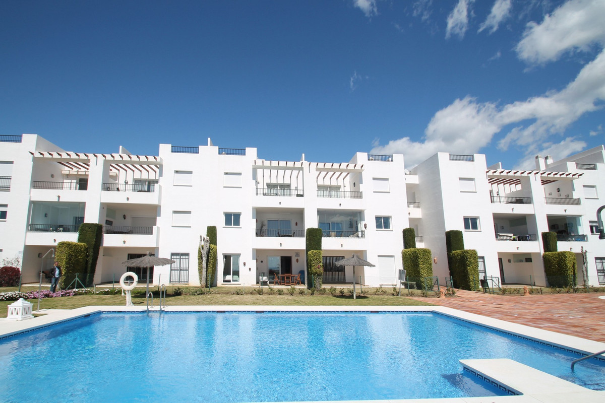 South facing two bedroom garden apartment within a gated complex with gardens and a large swimming p,Spain