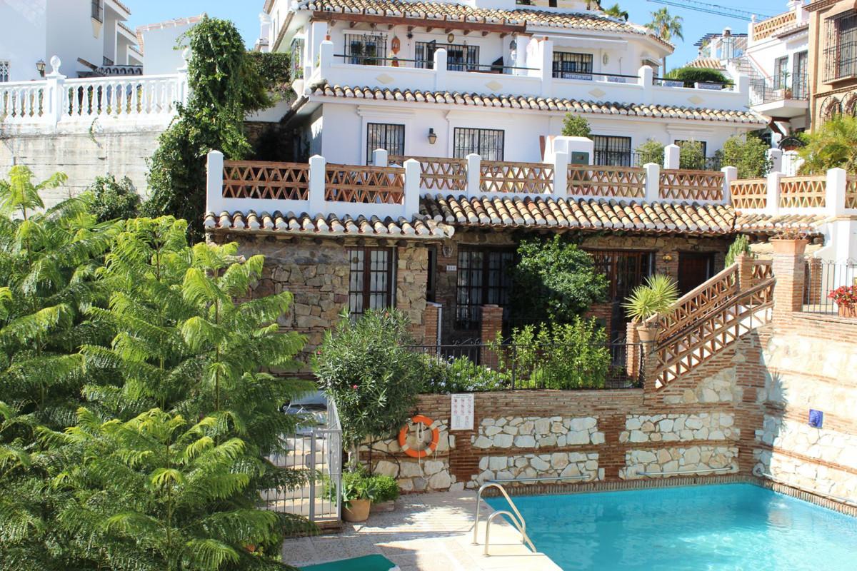 A two bedroom, two bathroom duplex apartment in the popular Puebla Aida development in Mijas Golf.  ,Spain
