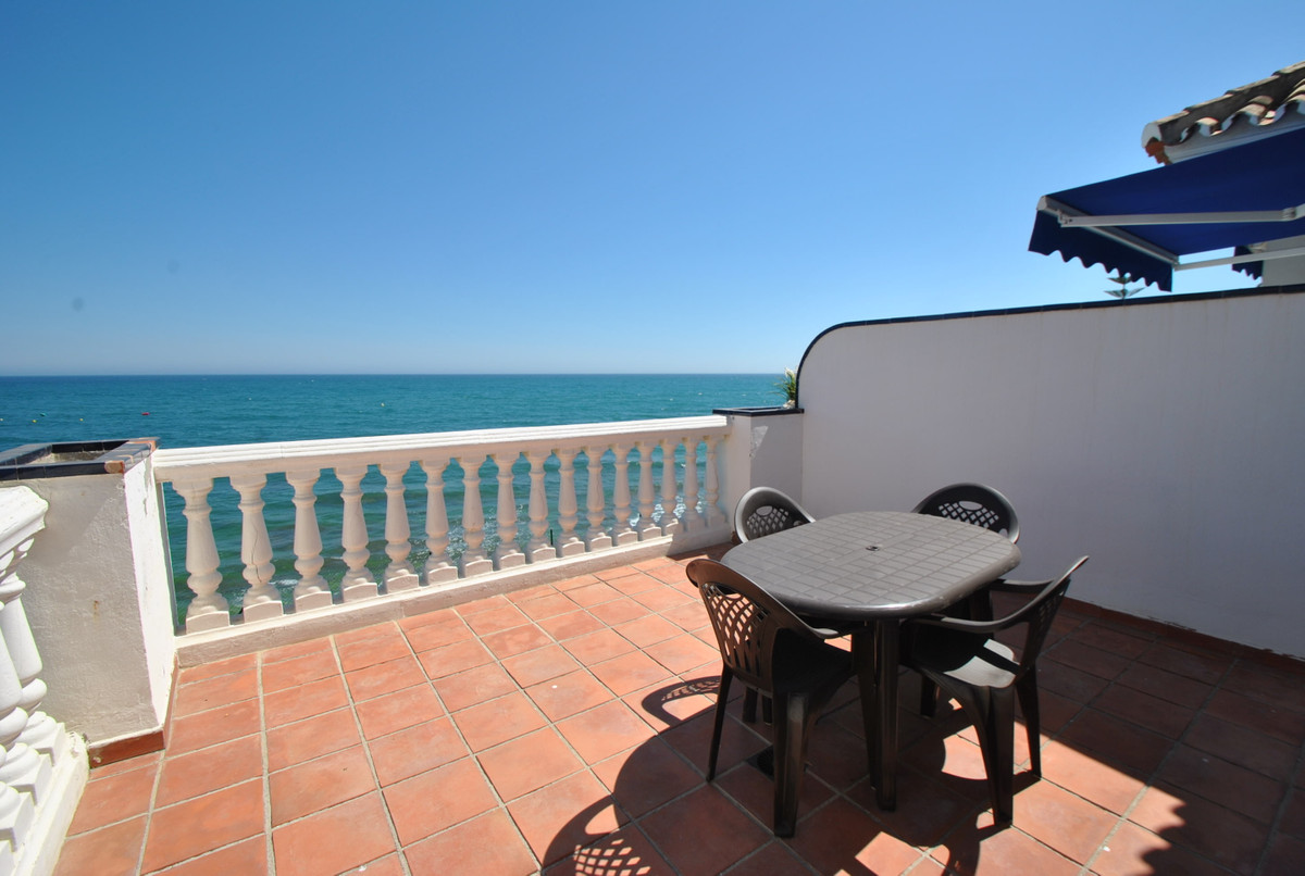 A superb beachfront property located in Mijas Costa with open panoramic sea views and direct access ,Spain