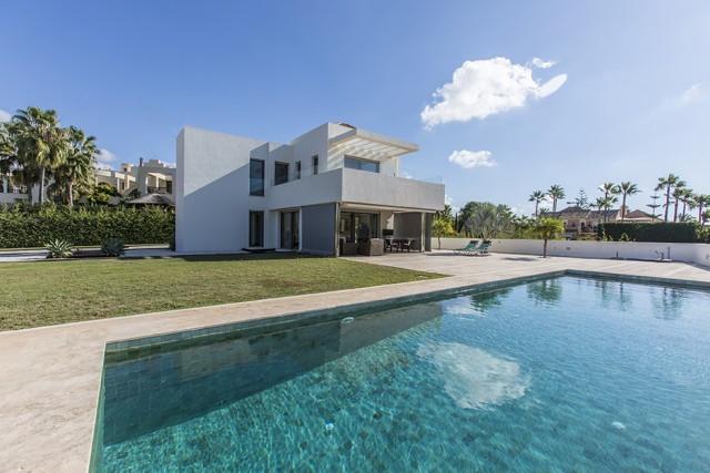 Newly built modern villa on a big plot in the urbanization Bahia de Marbella only a few meters away ,Spain