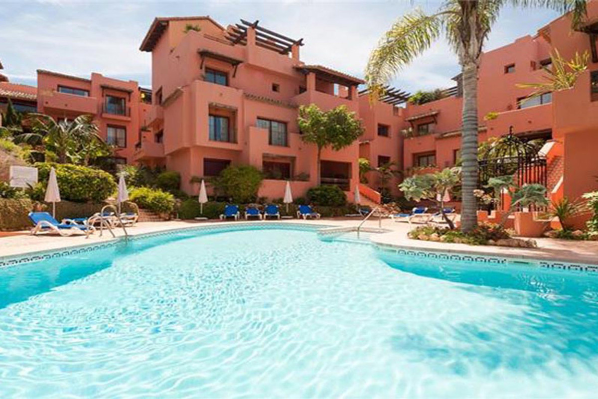 Penthouse beachside in the exclusive area of Elviria, Marbella! This stunning penthouse is within sh,Spain