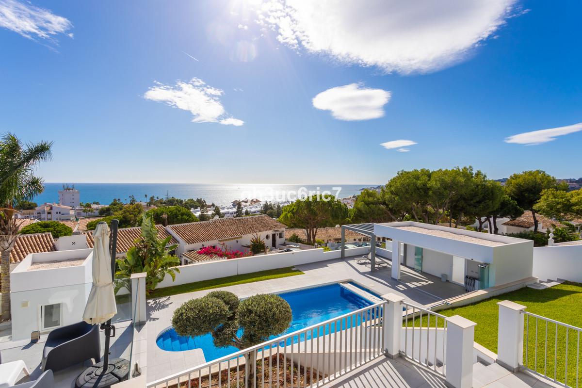 A superb contemporary villa nestled above the popular sea side village of La Cala de Mijas with magn,Spain