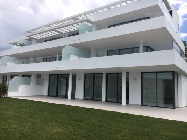 Newly built 3 bedroom 2 bath apartment ground floor with huge private garden, located in a renowned ,Spain