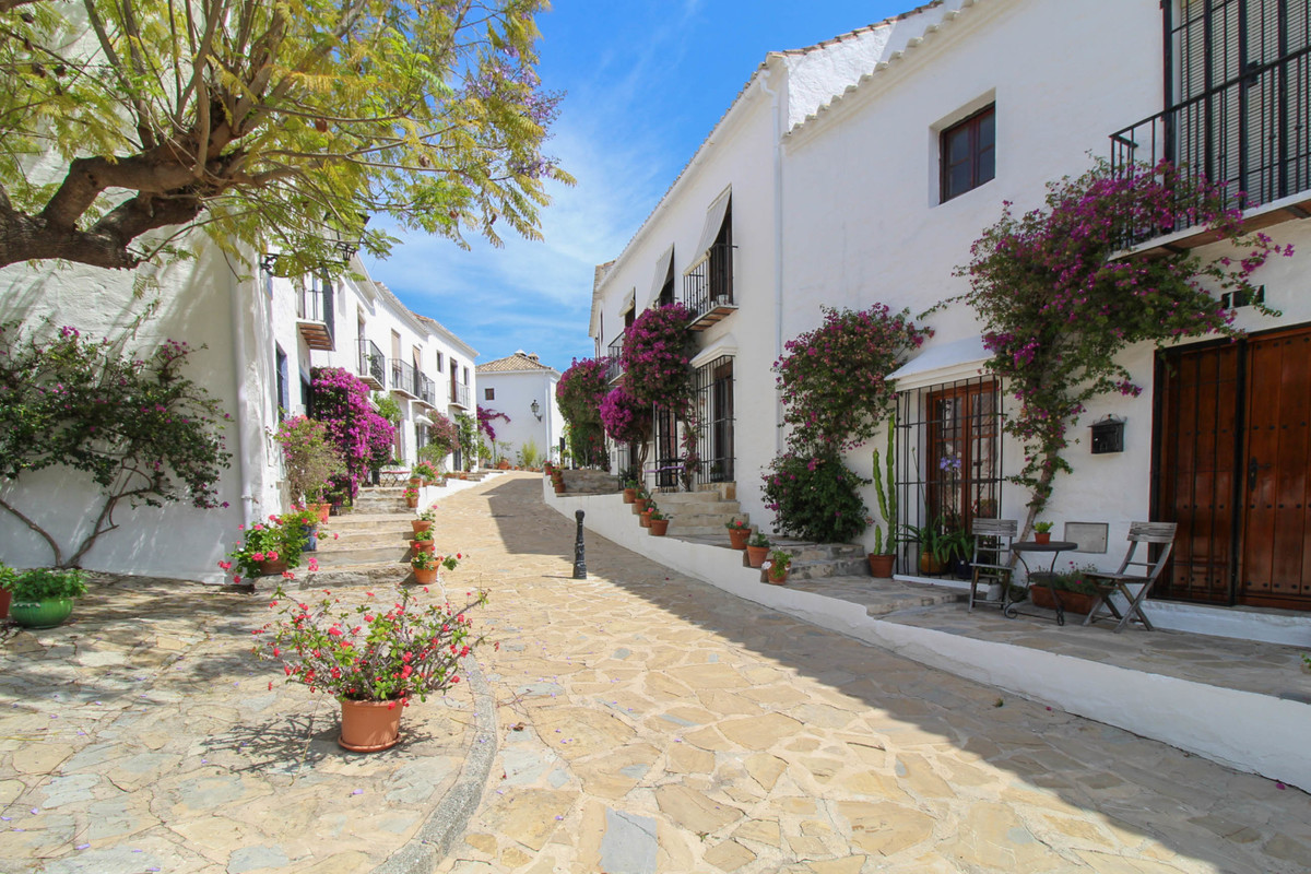 Charming semi detached house situated in the heart of the Las Brisas area in Nueva Andalucia. The ho,Spain