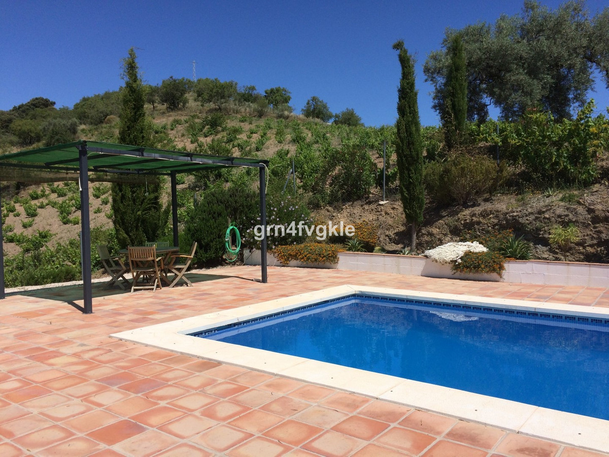 This traditional farmhouse is located in the beautiful region of La Axarquia, in Malaga, next to the,Spain