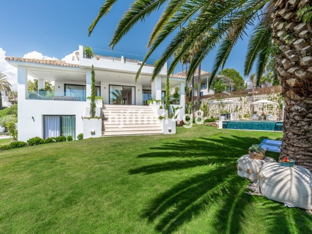 Stunning five bedroom villa with breathtaking views nestled in the hills of Nueva Andalucia. This un,Spain