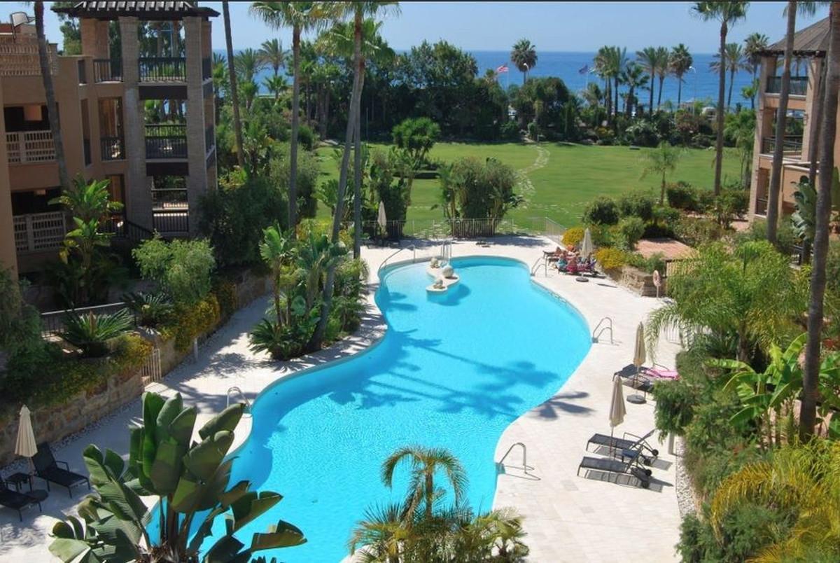 Beautiful beachfront apartment in prestigious gated complex, located in San Pedro de Alcantara.   Mo,Spain