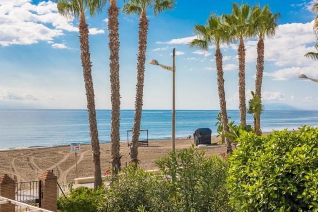 FRONT LINE BEACH COMPLEX WITH SEA VIEWS. This 2 bedroom 2 bathroom duplex top floor apartment is onl,Spain