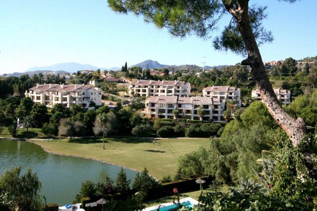Fantastic front line golf ground floor corner apartment with direct access from the terrace to the c,Spain