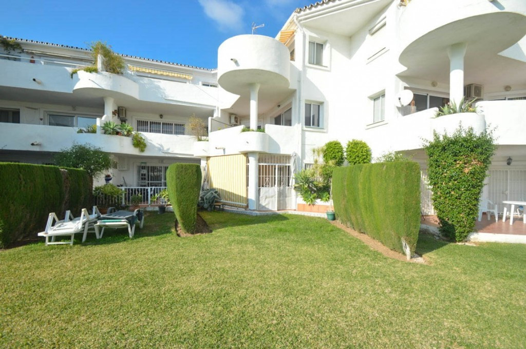 Large garden apartment with direct access to the communal garden located in Mijas Golf..  It is dist,Spain