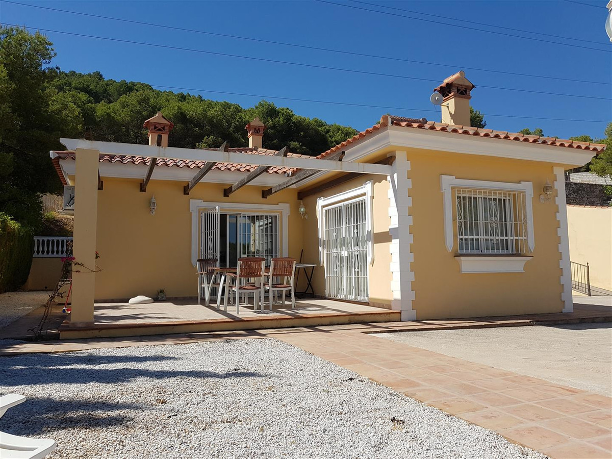 An immaculate one level villa in and elevated position with easy access via a gated driveway to the ,Spain