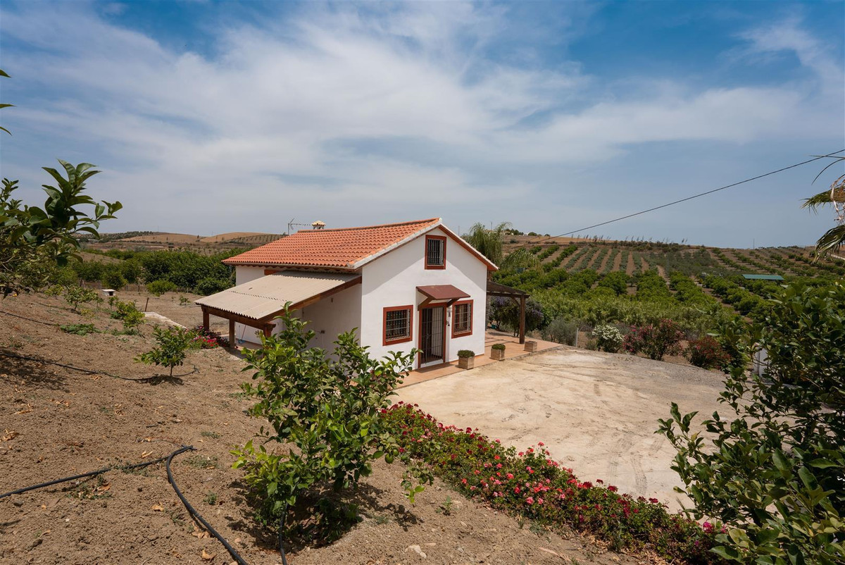 Rural 2 bedroom country house situated on a large plot north of Rio Grande.   A beautiful south faci,Spain