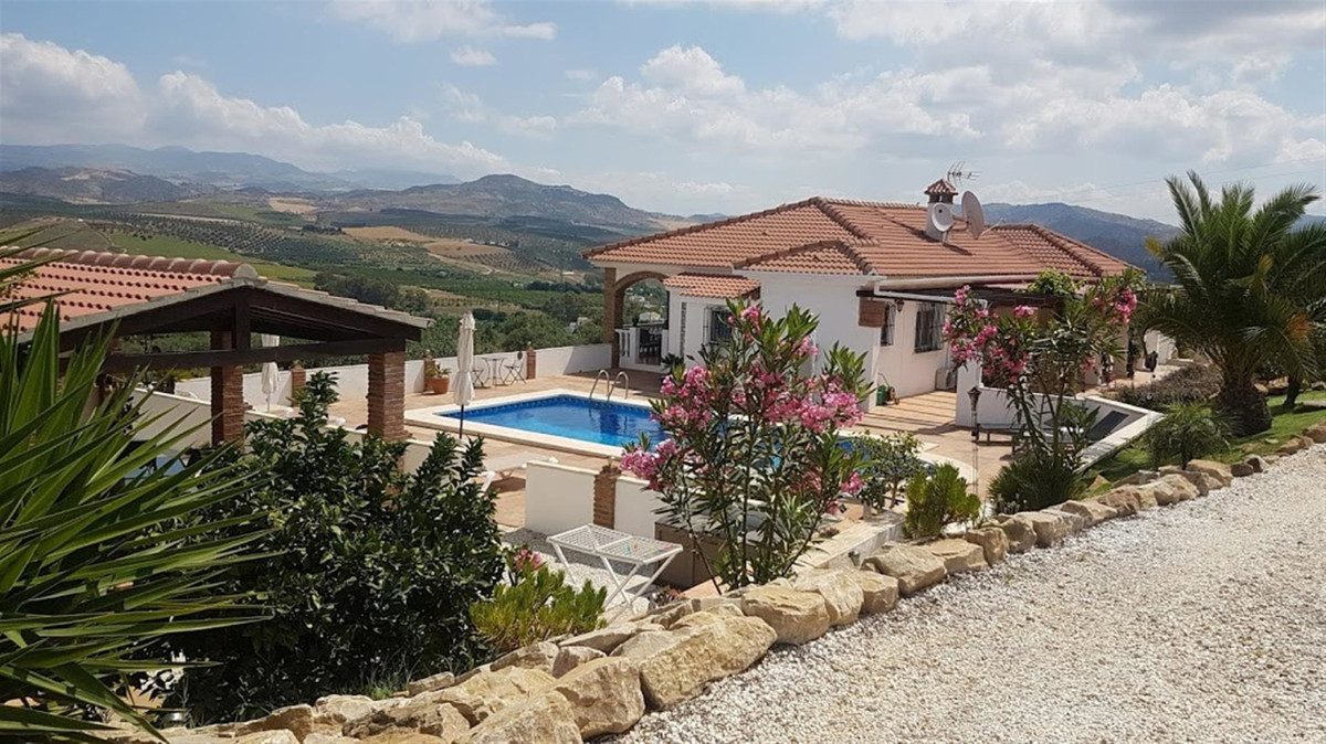 This property is presently divided into three sections and is currently operational as a self cateri,Spain